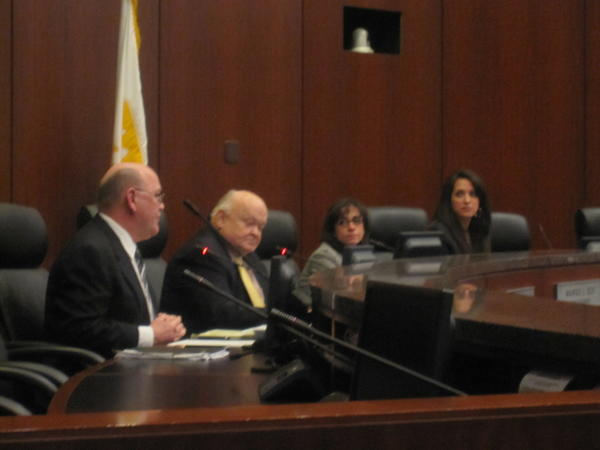 Naperville Councilman Doug Krause, Mayor George Pradel, City Attorney Margo Ely and City Clerk Pam LaFeber discuss a proposed referendum that would have asked taxpayers whether the city should stop implementation of electric smart meters and dismantle the equipment.