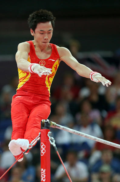Kai Zou of China competes on the horizontal bar in the Artistic Gymnastics Men's Team final on Day 3 of the London 2012 Olympic Games at North Greenwich Arena on July 30, 2012 in London, England.