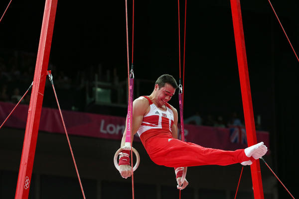 Kristian Thomas of Great Britain competes on the rings in the Artistic Gymnastics Men's Team final on Day 3 of the London 2012 Olympic Games at North Greenwich Arena on July 30, 2012 in London, England.