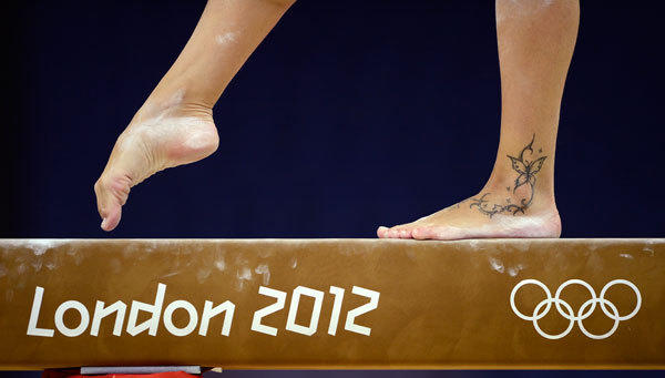 The butterfly tattoo of Vanessa Ferrari of Italy is seen as she attends a gymnastics training session at the O2 Arena before the start of the London 2012 Olympic Games July 26, 2012.