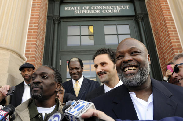 Ronald Taylor, left, and George Gould rejoice with family and friends in front of Superior Court in Vernon on April 1, 2010, after a judge reversed their murder convictions and released them after serving 16 years in prison. Taylor died in October 2011.