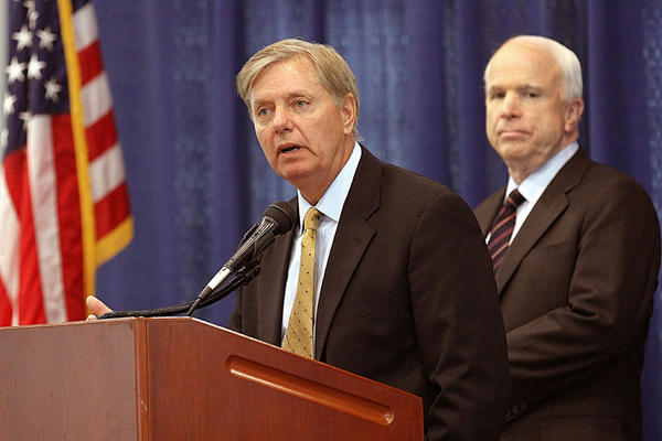 Sen. Lindsey Graham and Sen. John McCain take questions Monday night in Norfolk.