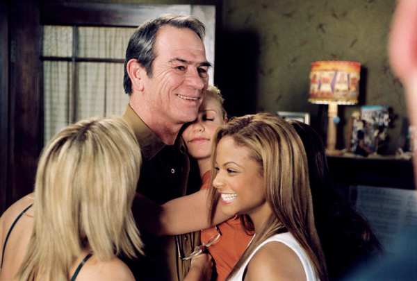 "Monica Keena, left, Tommy Lee Jones, Kelli Garner and Christina Milian in 2005's ""Man of the House."""
