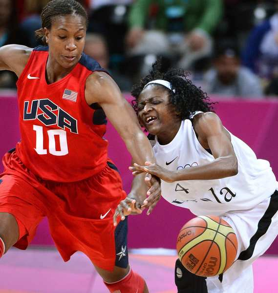 Team USA's Tamika Catchings steals the ball from Angola's Catarina Camufal.