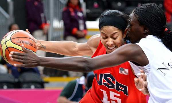 United States' Candace Parker tries to drive past Angola's Ngiendula Filipe during a preliminary round game at the 2012 London Olympics.