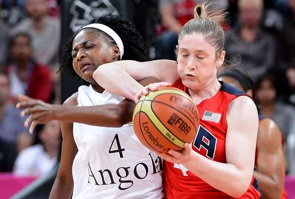 United States' Lindsay Whalen and Angola's Catarina Camufal battle during a preliminary game of women's basketball.