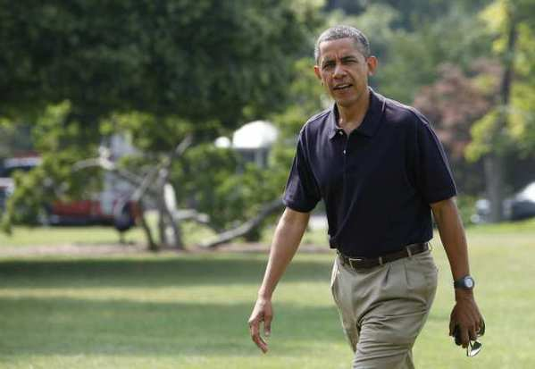 President Obama walks on the South Lawn of the White House after returning from a trip to Camp David.