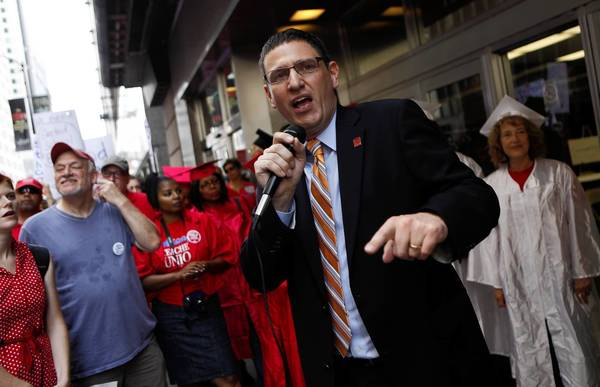 Jesse Sharkey, Chicago Teachers Union vice president, speaks at a rally outside Chicago Public Schools headquarters Wednesday.