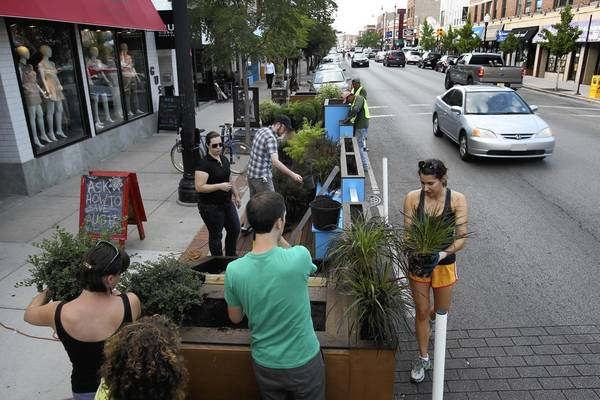 "A ""parklet,"" aka ""people spot,"" is being installed at 5228 N. Clark St. in Andersonville. Parklets are popular in San Francisco, though some have complained about the loss of curbside parking."