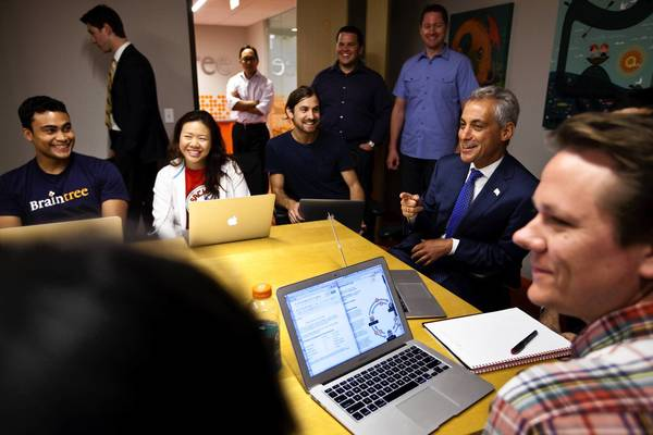 Mayor Rahm Emanuel, second from right, visits with employees of Braintree on Monday before before making an announcement about job growth.