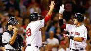 Will Middlebrooks #64 of the Boston Red Sox is congratulated by teammate Adrian Gonzalez #28 after hitting a two-run home run against the Detroit Tigers