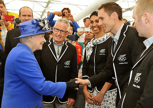 Queen Elizabeth II meets runner Nick Willis of New Zealand as she and the duke of Edinburgh, not pictured, tour the Olympic village.