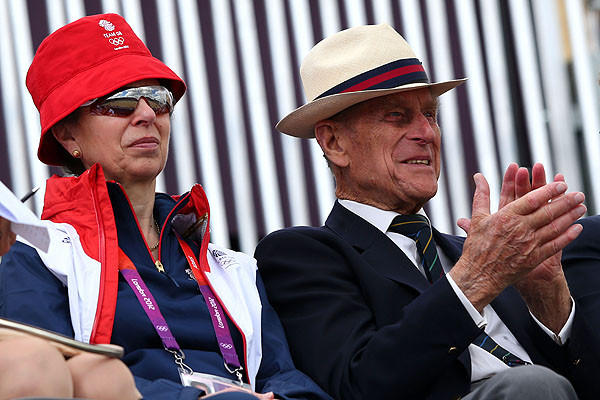 Princess Anne and Prince Philip watch the dressage equestrian event on Day 2.