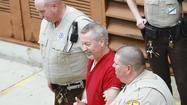 Drew Peterson joked and talked with his attorneys this morning as he put on a black and gray striped tie at the Joliet courthouse, a stark contrast to the tension before one of the highest profile trials in Will County history.