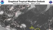 The disturbance in the Central Atlantic remained disorganized on Tuesday morning but still holds potential for gradual development.