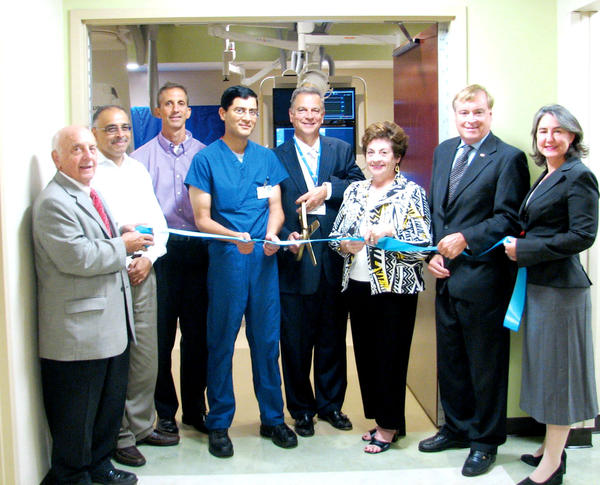 Attending the ribbon-cutting ceremony Monday for City Hospitals new interventional radiology suite in Martinsburg, W.Va., were, from left, George Karos, mayor of Martinsburg; Drs. Sanjay Saluja, John Blanco and Vivek Padha, all from Martinsburg Radiology Associates; Anthony Zelenka, chief administrative officer at City Hospital; Diane Dailey of W. Harley Miller Contractors; Rick Pill, chairman of the West Virginia University Hospitals-East board; and Tracey Eberling, chairwoman of the board of the Chamber of Commerce of Martinsburg and Berkeley County.
