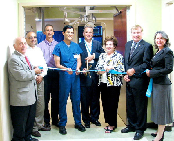 Attending the ribbon-cutting ceremony Monday for City Hospital¿s new interventional radiology suite in Martinsburg, W.Va., were, from left, George Karos, mayor of Martinsburg; Drs. Sanjay Saluja, John Blanco and  Vivek Padha, all from Martinsburg Radiology Associates; Anthony Zelenka, chief administrative officer at City Hospital; Diane Dailey of W. Harley Miller Contractors; Rick Pill, chairman of the West Virginia University Hospitals-East board; and Tracey Eberling, chairwoman of the board of the Chamber of Commerce of Martinsburg and Berkeley County.