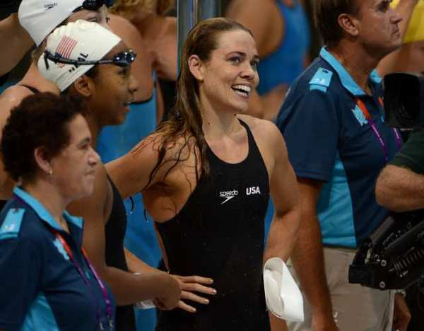 Natalie Coughlin is all smiles after competing in a preliminary heat on Saturday.