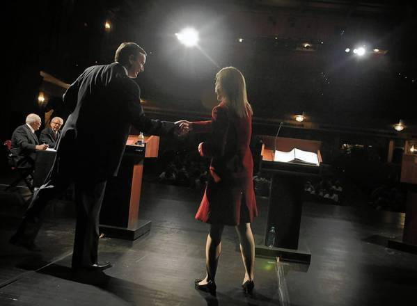 07.30.2012 - New London, CT - Senate candidates Chris Murphy and Susan Bysiewicz shake hands before their debate Monday night at the Garde Arts Center in New London, Ct.. Photograph by MARK MIRKO | mmirko@courant.com
