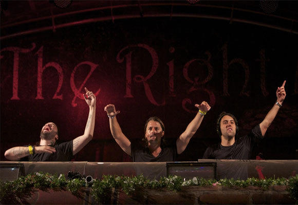 Electronic dance DJs Swedish House Mafia, performing at Tomorrowland 2012 in what is said to be one of their last gigs together as a trio.