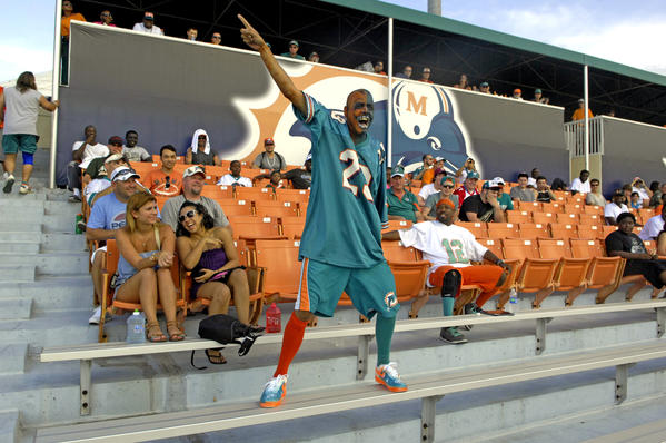 Manny Lopez of North Miami leads fans in a cheer for their team  during day four of Dolphins training camp.