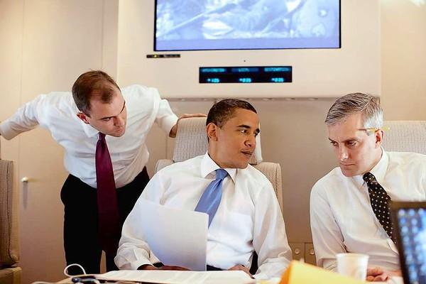 Ben Rhodes, left, and Denis McDonough work on the speech with President Obama on Air Force One en route to Cairo.