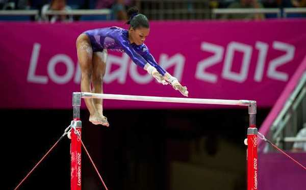 Gabrielle Douglas competes on the uneven bars.