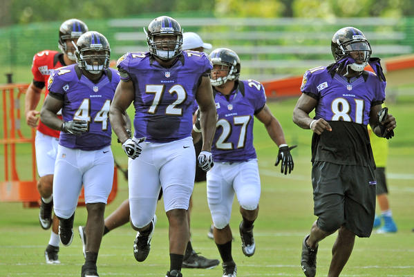 Vonta Leach (left) and Kelechi Osemele, Ray Rice and Anquan Boldin take the field at Ravens camp.