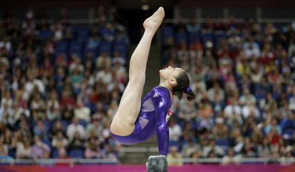 Kyla Ross performs on the balance beam.