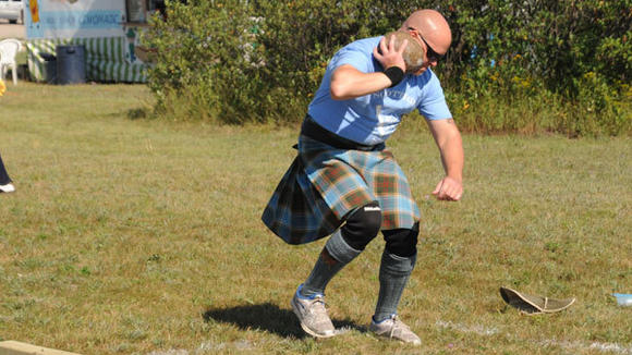Jason Cherry of Gaylord attempts the stone throw during Saturday's Scottish Games.
