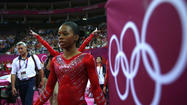Gabrielle Douglas of the U.S. walks after performing on the asymmetric bars during the women's gymnastics team final in London
