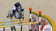 Sweden's Sara Algotsson Ostholt clears a fence to win silver during the Eventing Individual Jumping equestrian event