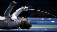 South Korea's Choi celebrates defeating China's Ma during their men's individual foil quarterfinal fencing competition