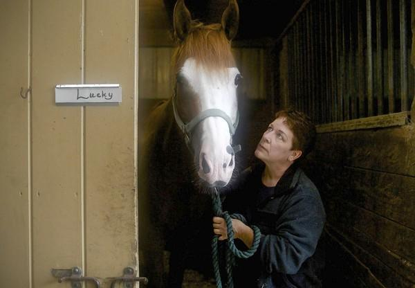 Lisa Cooper, shown here with Lucky, is a registered nurse who started volunteering at Y-Knot Farm in Quaker Hill in 2007 and bought Lucky, her first horse, as a 46th birthday present to herself in 2008.