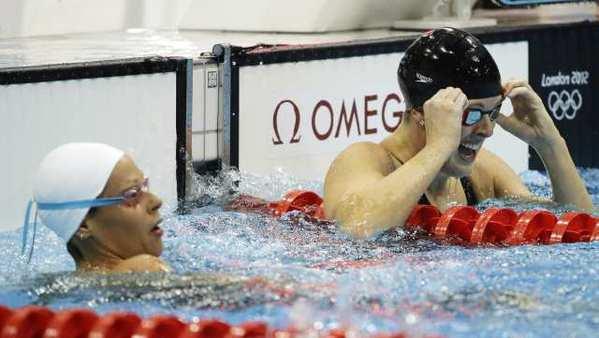 Allison Schmitt, right, reacts after winning the gold medal.