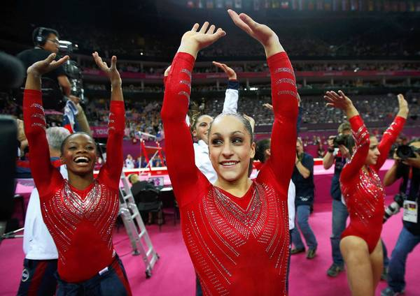 Jordyn Wieber of the U.S., center, and her teammates celebrate their gold medal victory in the  Artistic Gymnastics Women's Team competition at the London 2012 Olympic Games. Team Russia took silver and Team Romania won bronze.