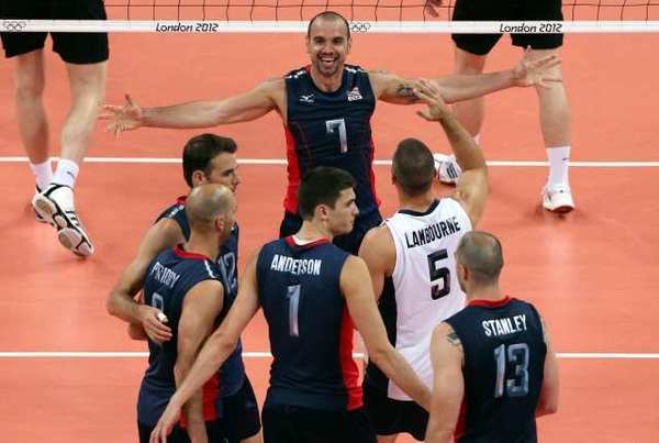 Members of the men's U.S. Olympic volleyball team celebrate their victory over Germany.
