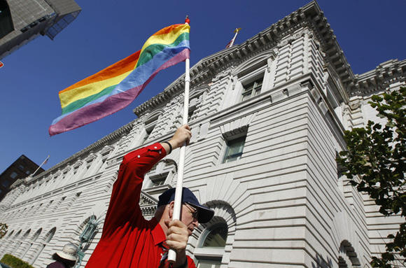 Ken Pierce of Equality Action Now, waves a rainbow flag outside aSan Francisco courthouse in Dec. 2011.