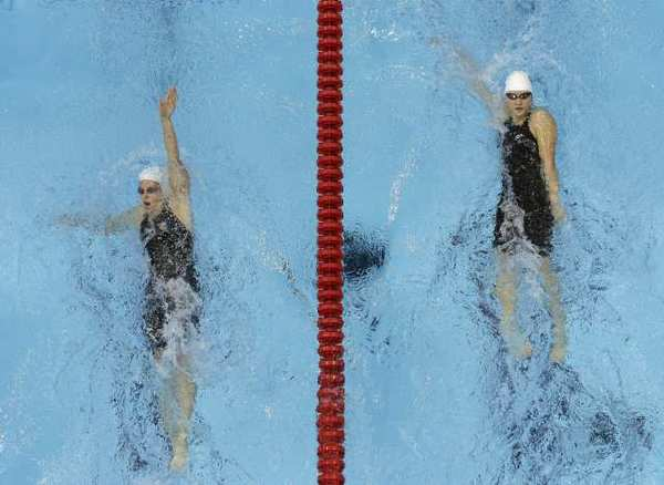 China's Ye Shiwen, right, and Australia's Alicia Coutts compete in the women's 200-meter individual medley.