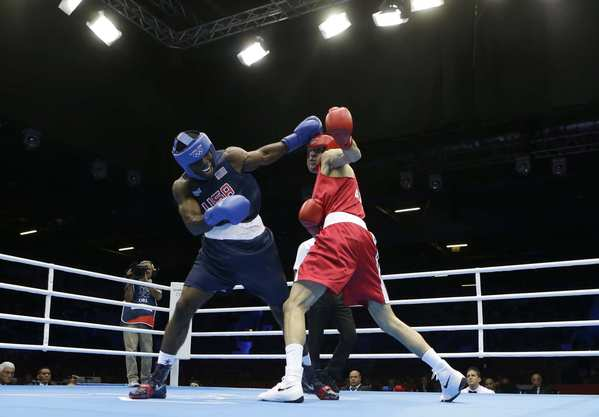 USA's Terrell Gausha fights Armenia's Andranik Hakobyan during a preliminary middleweight match.