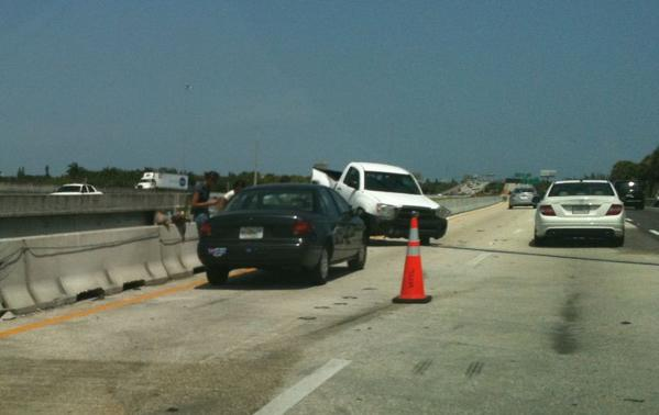 A Toyota Tundra pickup truck was hung up on a concrete median in an accident on eastbound I-595 in Davie