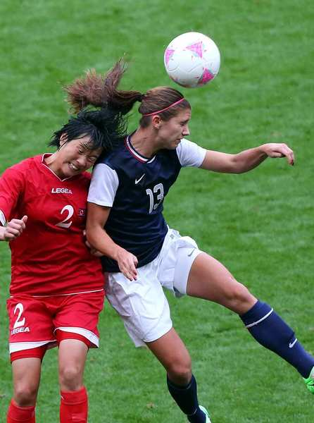 Team USA forward Alex Morgan goes up for a header against North Korea's Kim Myong Gum.