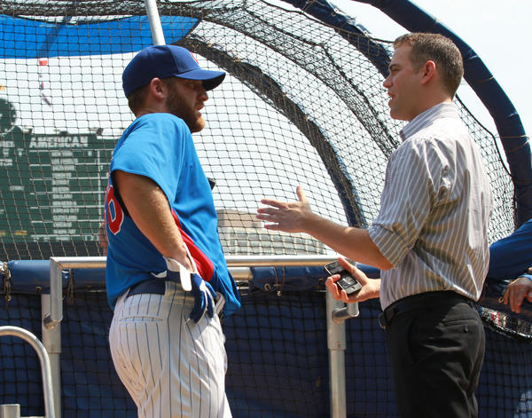Ryan Dempster talks to Theo Epstein at Wrigley Field in May.