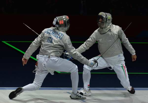 Italy's Diego Occhiuzzi, left, fences Hungary's Aron Szilagyi during the gold medal sabre bout. Szilagyi won the gold medal.