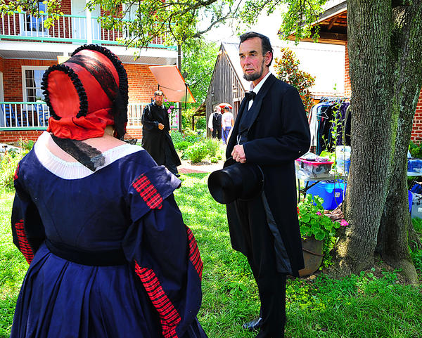 Actor Fritz Klein portrays President Abraham Lincoln and Jennifer Mowbray portrays Mary Todd Lincoln Tuesday at Plumb Grove Mansion where they were being filmed for a Smithsonian Channel documentary.