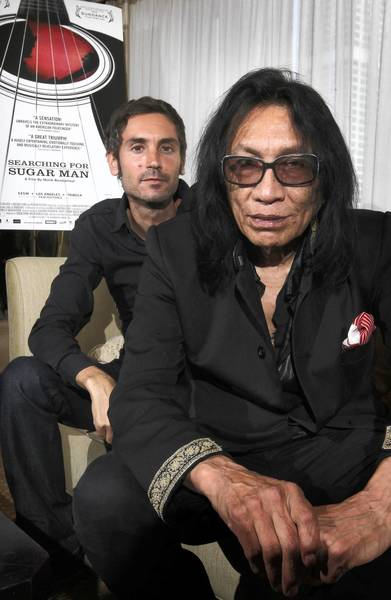 Director Malik Bendjelloul, left, and singer Rodriguez at the Peninsula Hotel in Chicago.