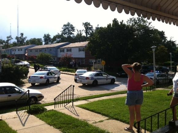 Neighbors look on as police investigate a fatal officer-involved shooting in Medfield