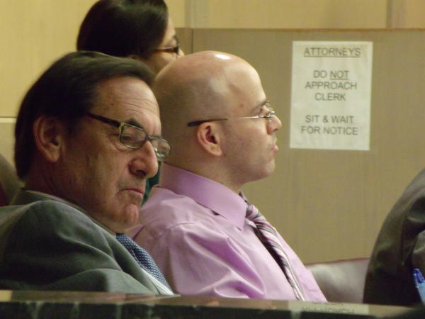 Seth Penalver, left, and defense lawyer Hilliard Moldof watch the video of the Caseys Nickelodeon murders in court on July 31, 2012.