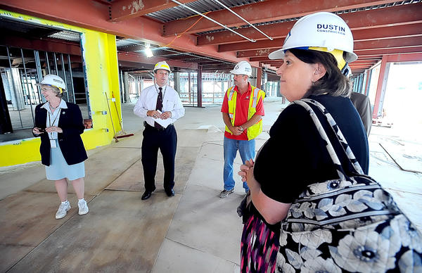 Washington County Free Library Director Mary Baykan, right, joined Joe Kroboth, center, and the Washington County Commissioners for a construction tour of the new library Tuesday afternoon.