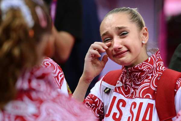 Russia's Victoria Komova cries after her team finished second to the Americans in  women's team gymnastics.